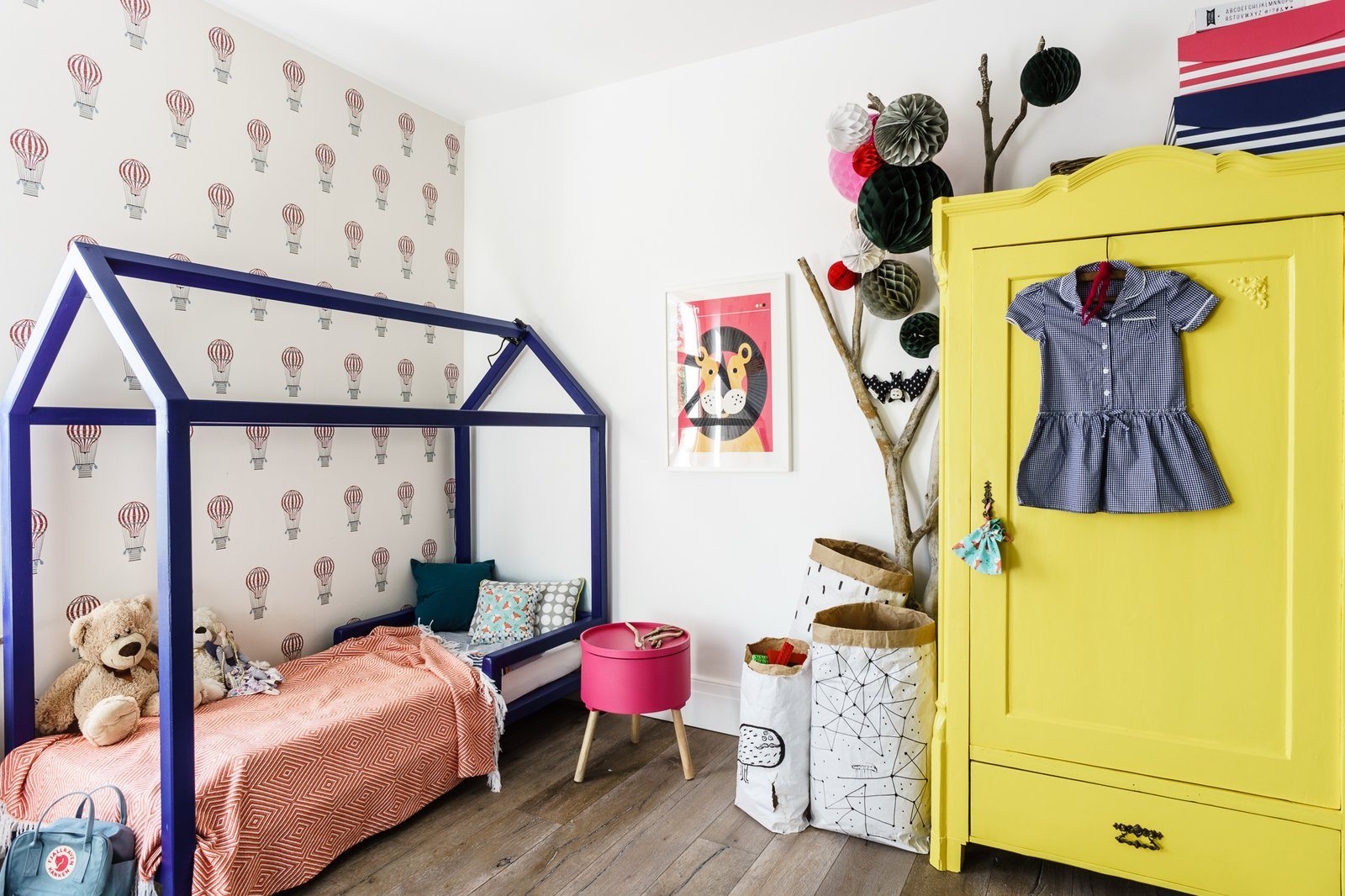 Kids Room, Bedroom Room Type, Playroom Room Type, Bed, Light Hardwood Floor, Pre-Teen Age, Toddler Age, Dresser, and Neutral Gender These 8 Toddler Room Ideas Will Make You Want to Be a Kid Again - Photo 12 of 12 -