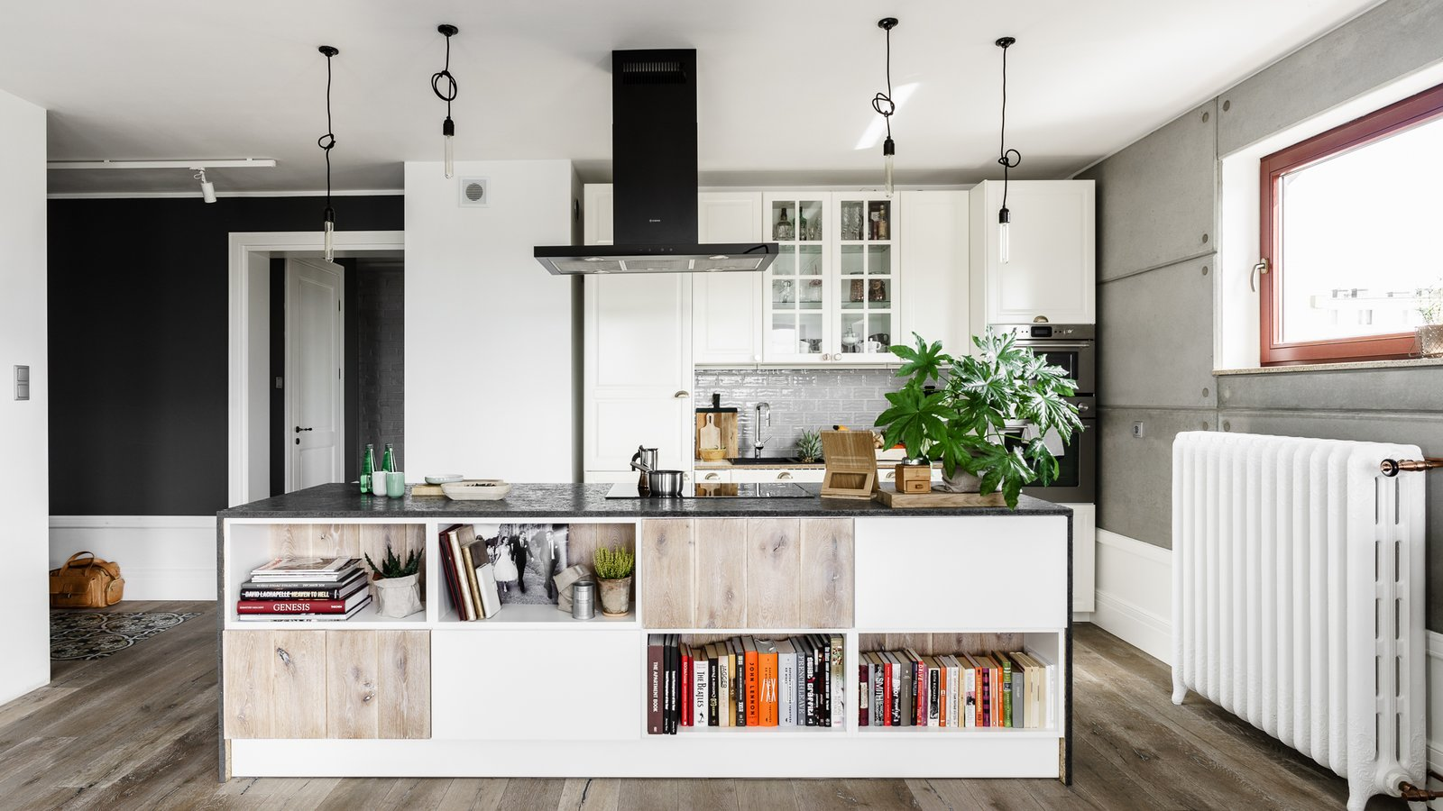 Kitchen, Medium Hardwood Floor, Granite Counter, Glass Tile Backsplashe, White Cabinet, Cooktops, Pendant Lighting, Range Hood, and Subway Tile Backsplashe  Super Cool Kitchen Islands by Erika Heet from Loft in Poland