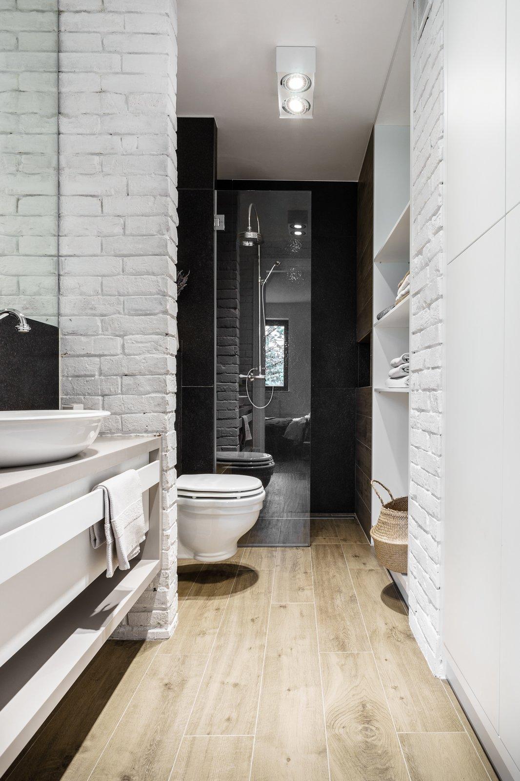 Bath Room, Corner Shower, Light Hardwood Floor, Vessel Sink, Engineered Quartz Counter, Enclosed Shower, Ceiling Lighting, and One Piece Toilet  Loft in Poland