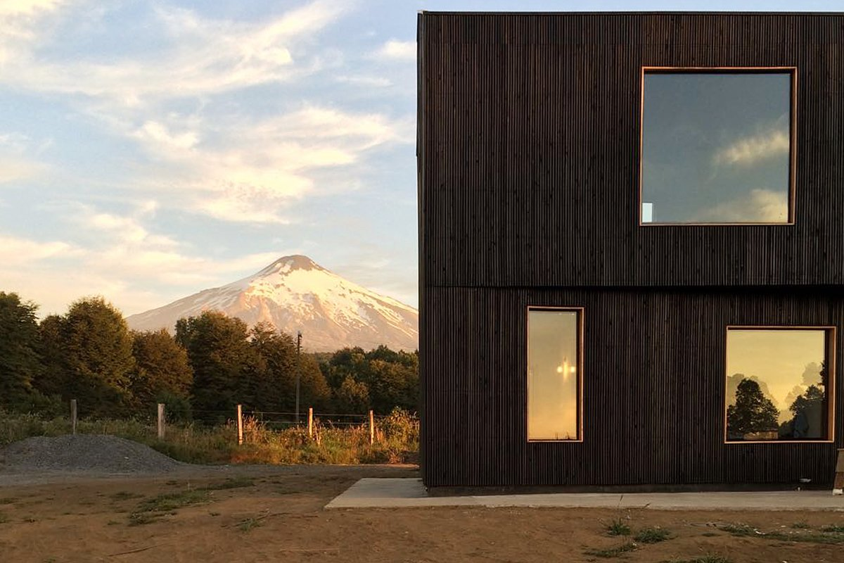 Exterior, House Building Type, Wood Siding Material, and Flat RoofLine  Photos from Casa Hualle