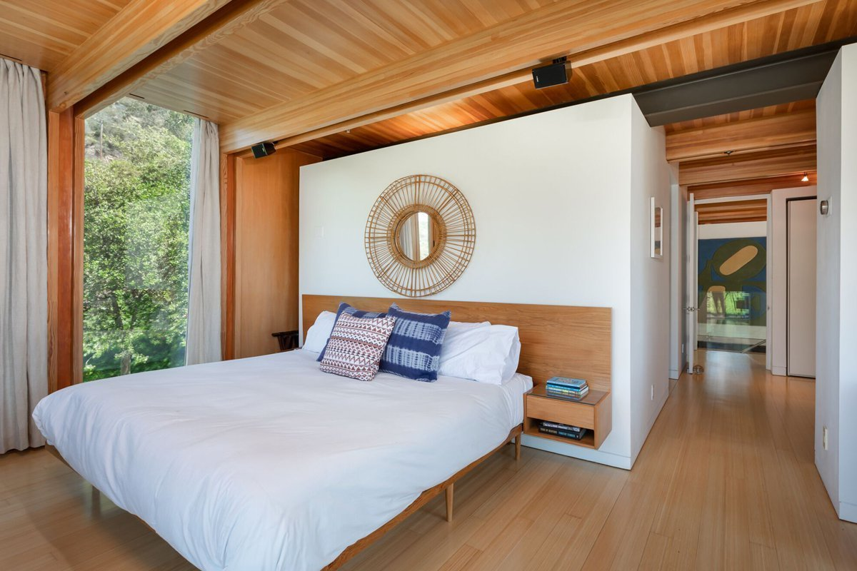 Bedroom, Ceiling Lighting, Bed, Night Stands, and Medium Hardwood Floor  Laurel Canyon Boxhouse