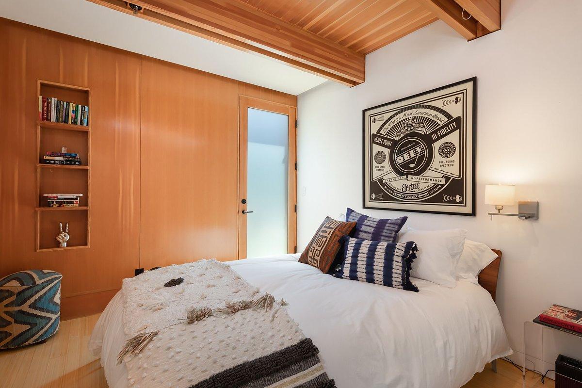 Bedroom, Wall Lighting, Bed, Medium Hardwood Floor, and Bookcase  Laurel Canyon Boxhouse