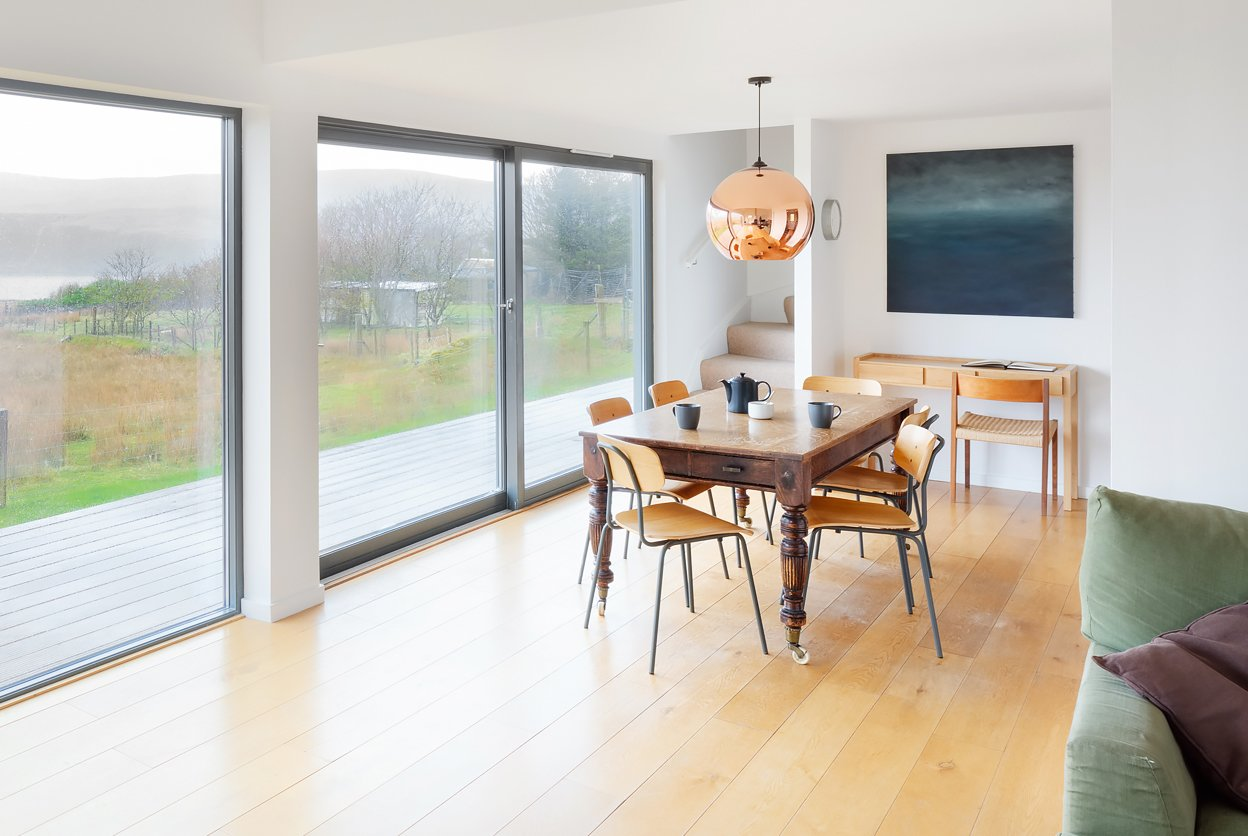 Dining Room, Light Hardwood Floor, Chair, Pendant Lighting, and Table  Harlosh Wood H