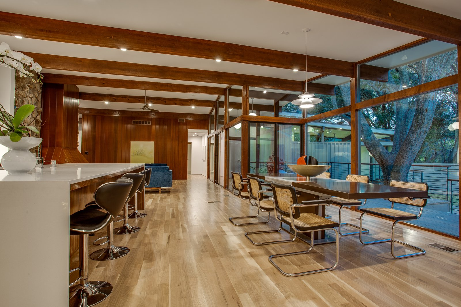 Dining Room, Table, Ceiling Lighting, Pendant Lighting, Recessed Lighting, Light Hardwood Floor, Chair, Stools, and Bar  1963 Post and Beam Mid Century Modern by Tavis Westbrook