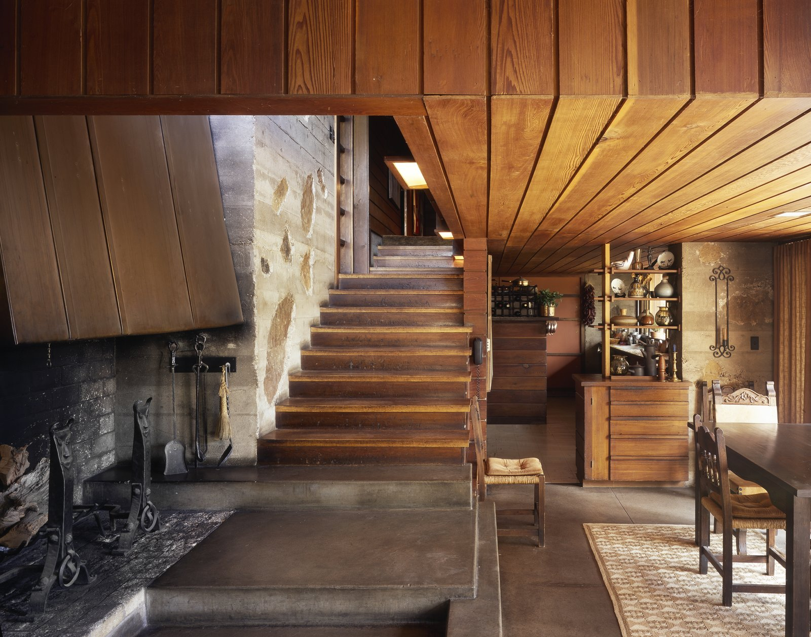 The Wood-Peterson house in Colorado Springs was built in 1950 by Ingraham and Ingraham, Architects, who used flat fieldstone set in poured concrete through much of the home. You'll notice they kept the stairwell clean by eliminating a railing and included built-in cabinets that appear in many of their homes.  Photo 3 of 5 in An Architect in Her Own Wright