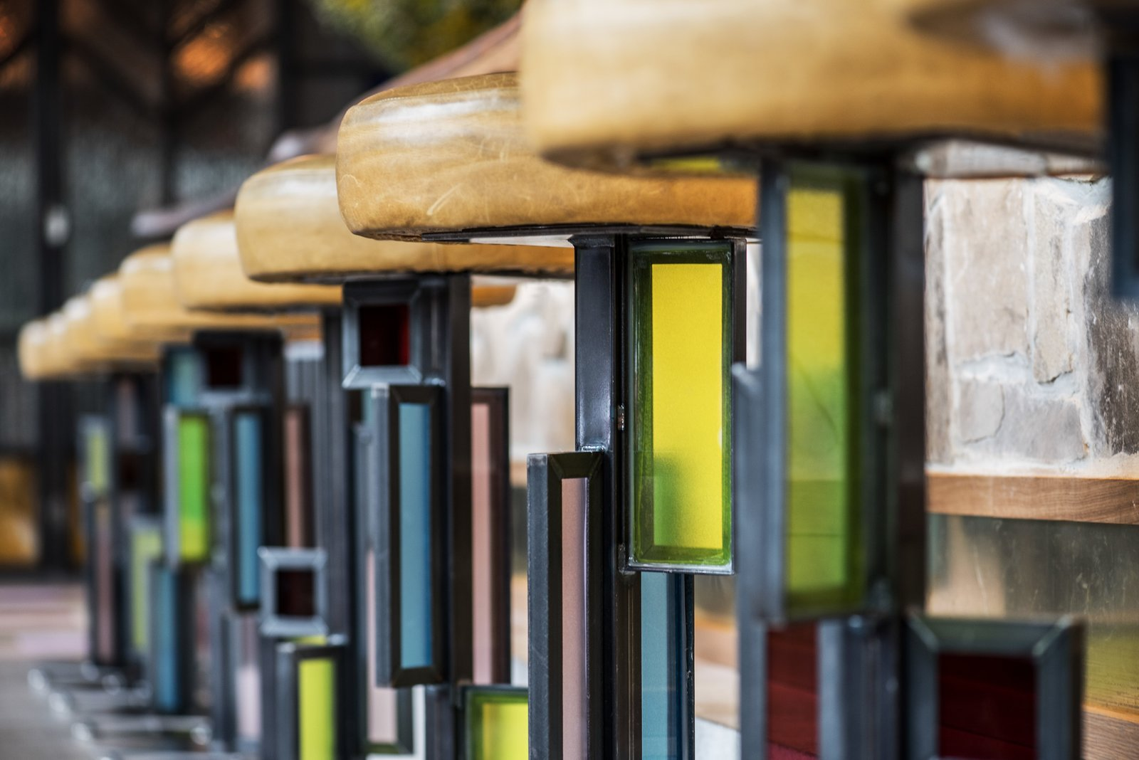 Designer Kevin Heisler designed and fabricated the custom, stained-glass barstools.