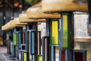Designer Kevin Heisner designed and fabricated the custom, stained-glass barstools.