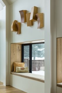 The homeowners are avid readers, and built-in reading nooks cater to their lifestyle and add warmth to the interiors.