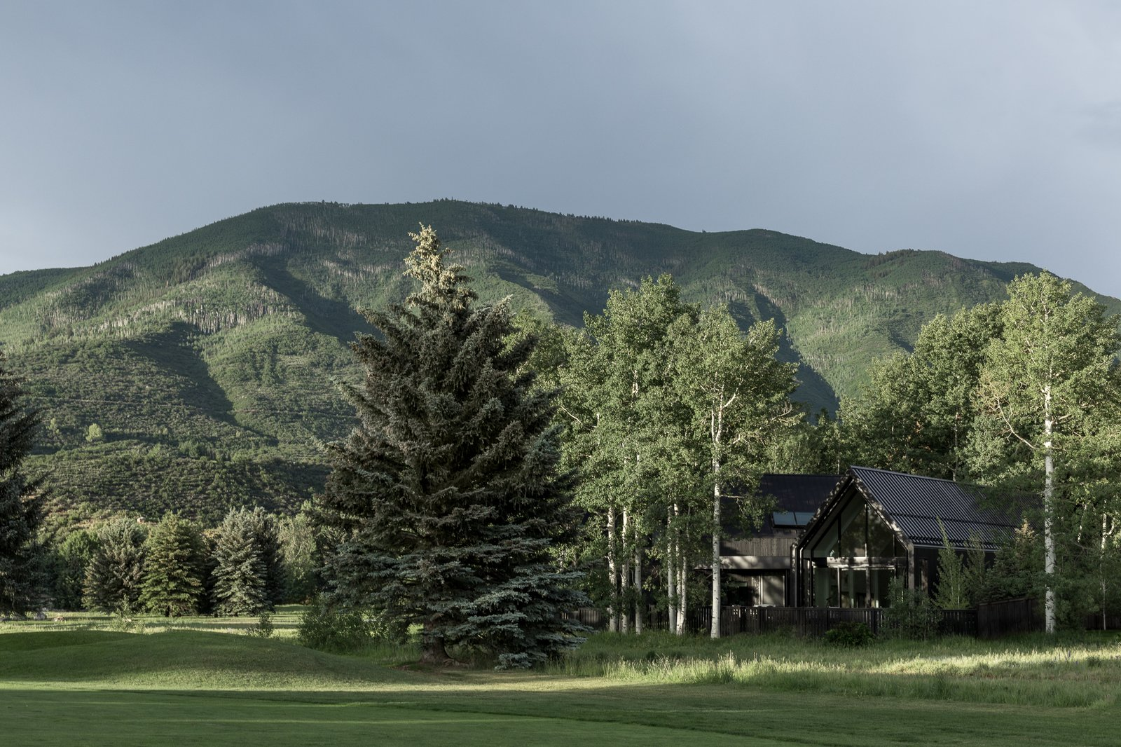 Exterior, Wood, Metal, Metal, Farmhouse, Gable, House, and Glass  Exterior Metal Farmhouse Photos from A Modern Farmhouse in the Colorado Mountains Teems With Art