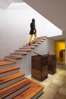 Luis Barragán left walls unadorned. Light switches, fixtures, and stair rails are often absent in his homes.