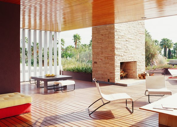 """While a two-story structure did not meet the zoning code, Richard Neutra bypassed that via his design of a """"gloriette,"""" an outdoor room flanked by aluminum louvers. Those panels shelter the home against the harsh desert elements and were recreated as part of the five-year restoration of Richard Neutra's original design."""