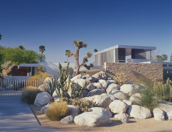 After much research, the original buff stone pictured was discovered at a quarry in Utah, which had since closed but reopened for the material sourcing for this project, the restoration of Richard Neutra's Kaufmann House. A mason worked there for a year and a half to accurately restore stone, chiseling and cutting blocks precisely in place to create a pleasing mosaic. Tops and bottoms of the stones were cut smooth to sit in horizontal position, allowing the sides and faces to be more organic as Richard Neutra intended.
