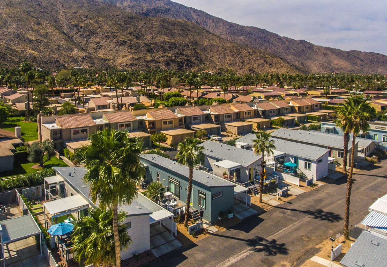 Exterior, Wood Siding Material, House Building Type, Shingles Roof Material, Prefab Building Type, and Shed RoofLine  Photo 6 of 10 in Tiny Homes in This Palm Springs Community Start at $155K
