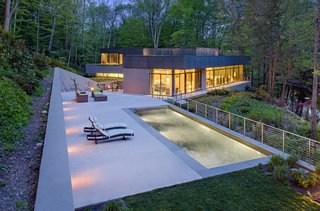 The Weston Residence nestles in a valley adjacent to the Saugatuck River. It's a small house, but takes advantage of its beautiful site in a way that purposefully blurs the distinction between the built and natural environment.