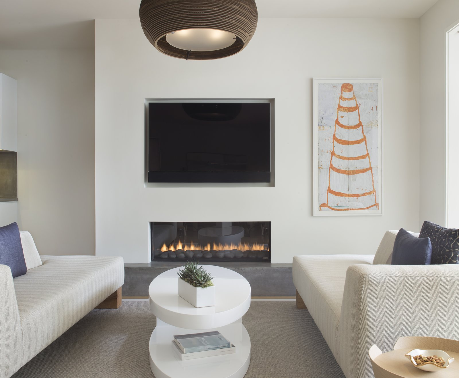 Living Room, Sofa, Gas Burning Fireplace, and Standard Layout Fireplace  Game On by rowland + broughton