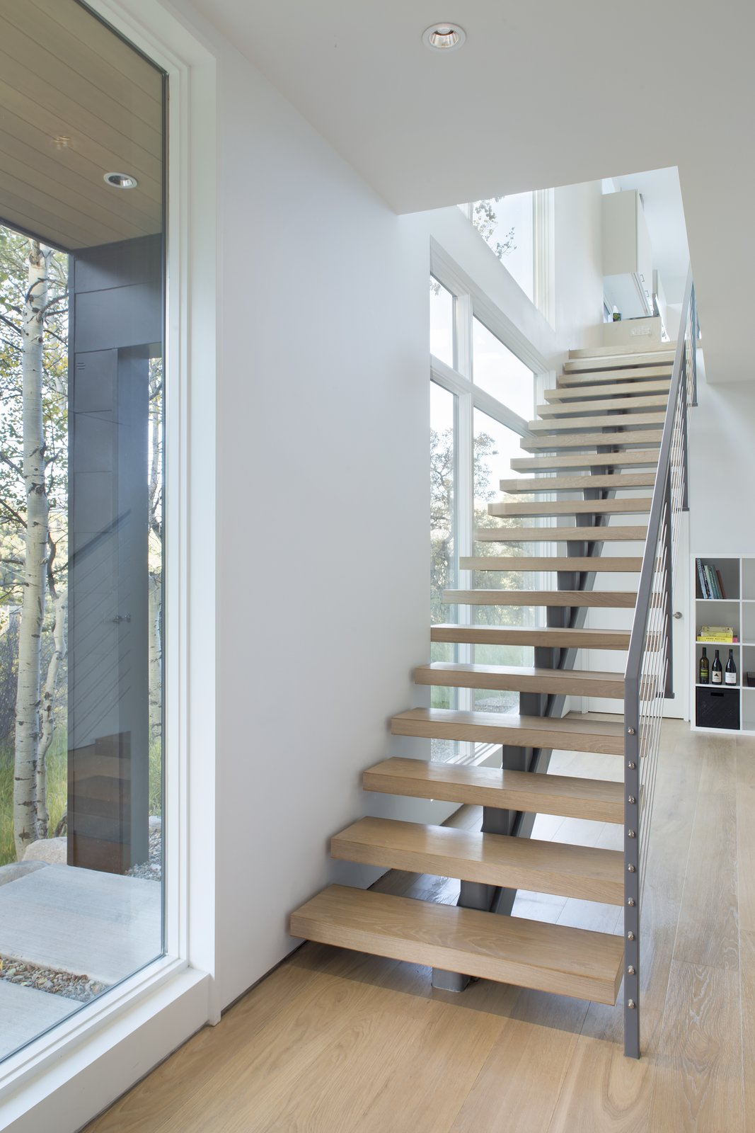 Staircase, Wood Tread, and Metal Railing  Black Magic by rowland + broughton