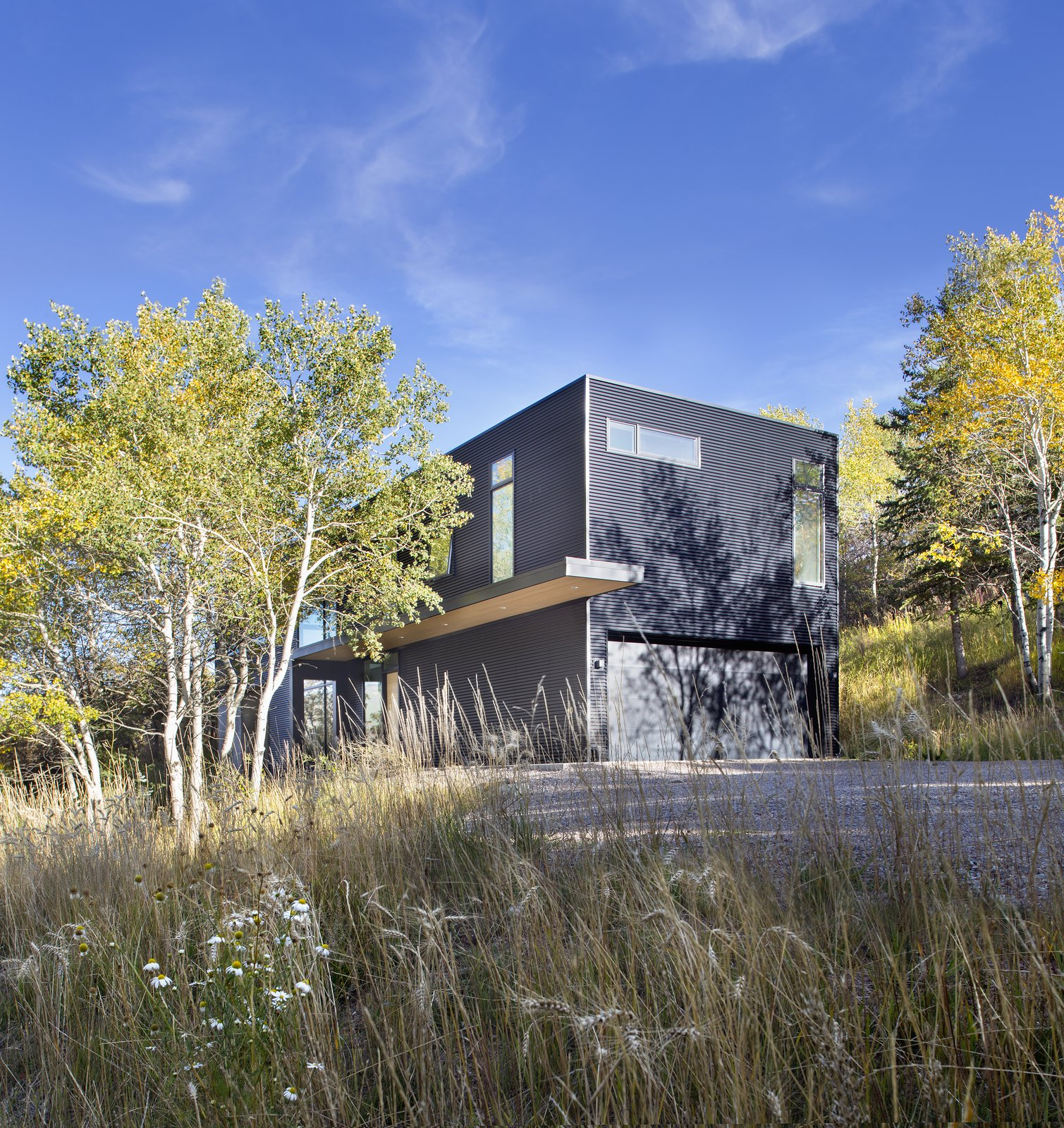 Exterior, Cabin Building Type, Concrete Siding Material, and Metal Siding Material  Black Magic by rowland + broughton