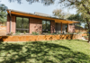 Modern home with Outdoor, Front Yard, Raised Planters, Wood Fences, Wall, Metal Fences, Wall, Grass, and Horizontal Fences, Wall. Front Photo 2 of Richardson House