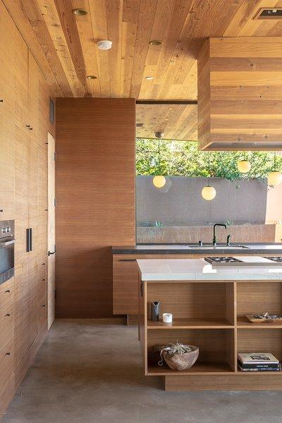 Kitchen, Range, Quartzite, Microwave, Concrete, Ceiling, Wood, Undermount, Range Hood, and Refrigerator  Best Kitchen Refrigerator Wood Quartzite Range Concrete Photos from San Clemente Modern