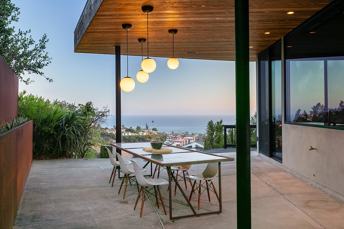 Outdoor, Side Yard, Hanging Lighting, Concrete Patio, Porch, Deck, Raised Planters, Metal Fences, Wall, and Retaining Fences, Wall  Photos from San Clemente Modern