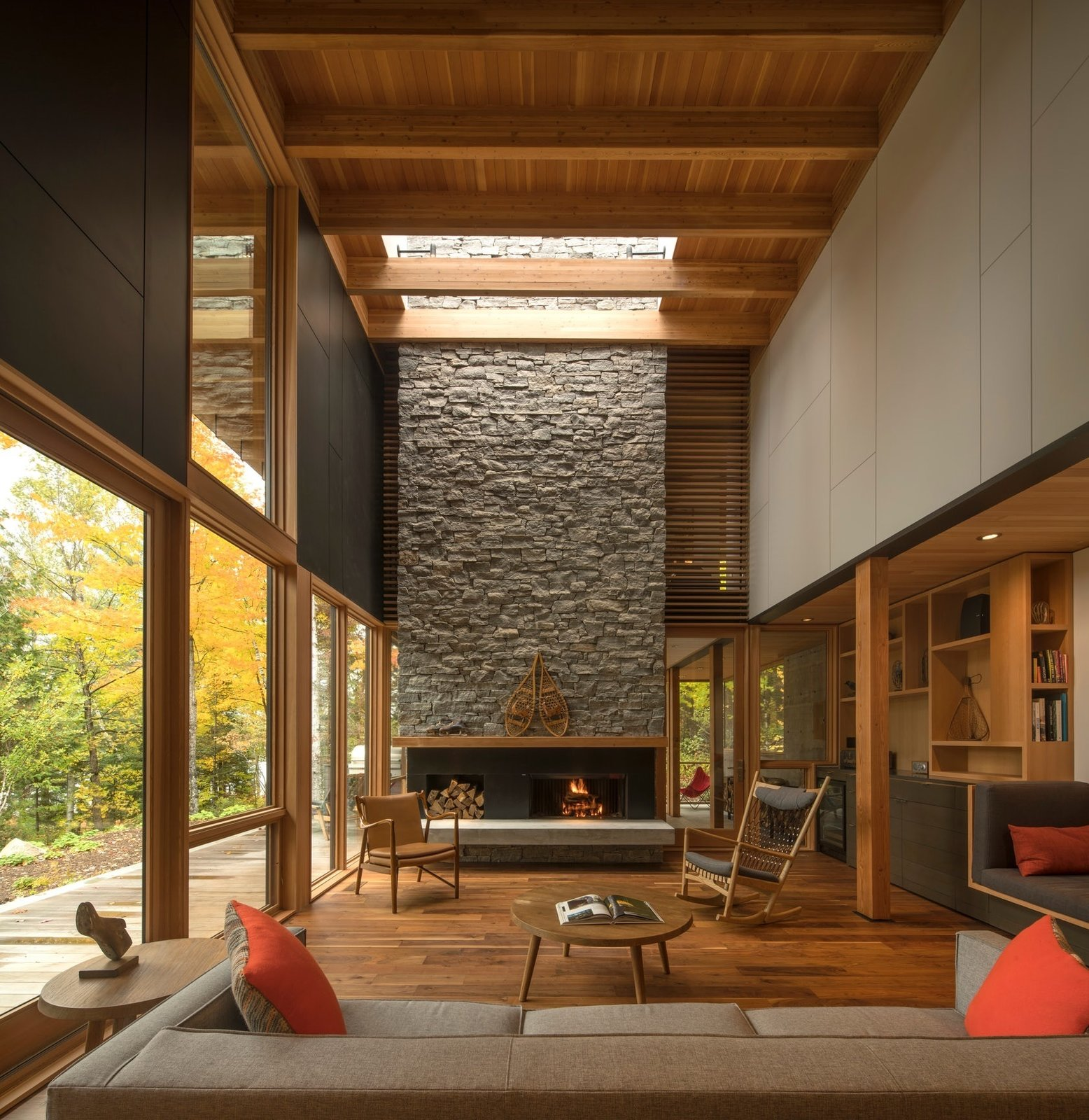 Living Room, Concrete Floor, Medium Hardwood Floor, Storage, Stools, Coffee Tables, Two-Sided Fireplace, Sofa, Wood Burning Fireplace, and Bookcase  The Bear Stand