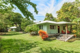 The sale includes two adjacent lots, each with a classic beach cottage in view of the ocean