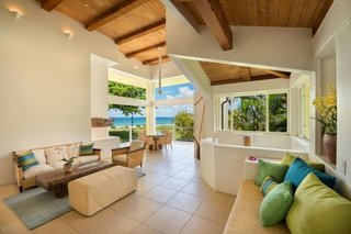 Living room in Main House with 15 ft high ceilings and expansive ocean views