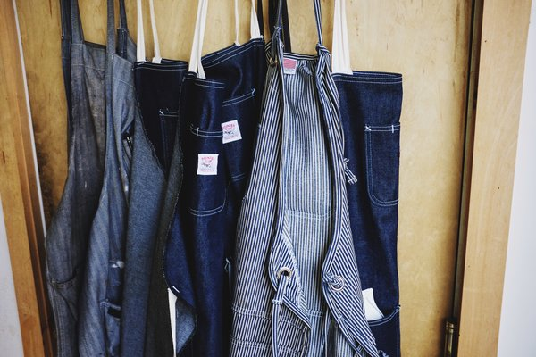Denim aprons adorn the door to Grovemade's manufacturing wing.