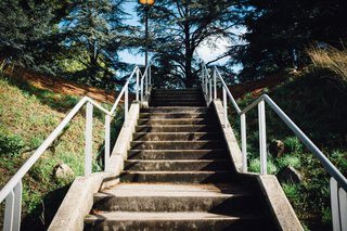 A cement staircase leads to the main Abbey grounds, where the iconic library sits.