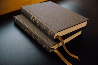 Two New Testament volumes of the new Reader's Bible in rich olive cloth-over-board bindings.