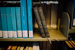 Two Reader's Bible volumes rest at an angle on the shelf at the Mt. Angel Abbey Library.