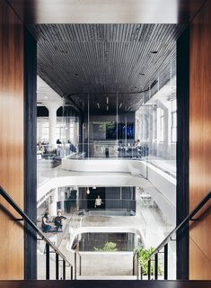 A Look Inside Squarespace NYC - Photo 8 of 10 - Vertical lines adorn ceilings and columns creating a rhythmic motion to this atrium space.