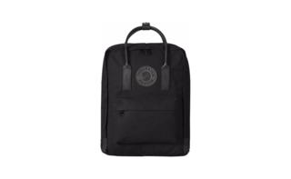 A leather-trimmed black on black Kånken backpack, compact for everyday carry.