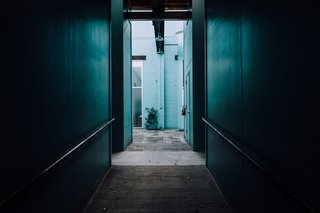 The Opinionated Leica Q - Photo 5 of 9 - Peering down a dark hallway into cerulean blue green.