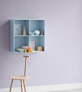 This small wall unit is a way to create impromptu storage at arm's reach.