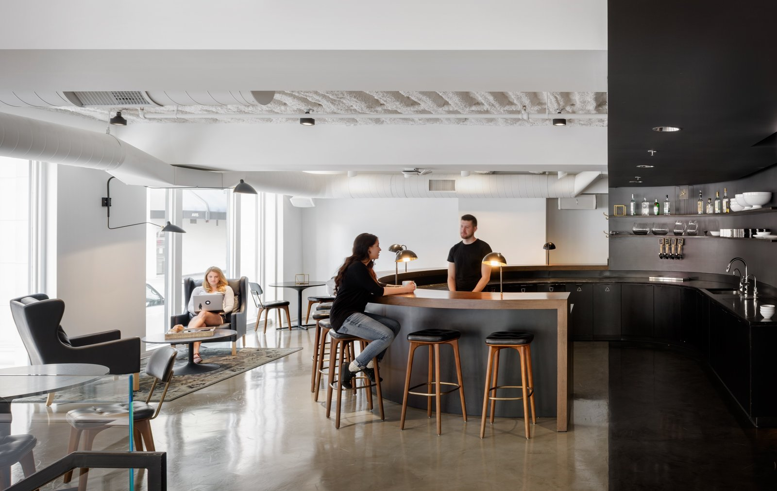 The large circular open bar and the harsh contrasts of black and white makes a dramatic yet engaging place for co-workers to congregate and connect.  Photo 2 of 12 in Step Inside Squarespace's Minimalist Portland Office