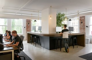 Having large standing spaces in common areas is a newer trend in office spaces, but they allow employees to work in the way that is best suited to them.