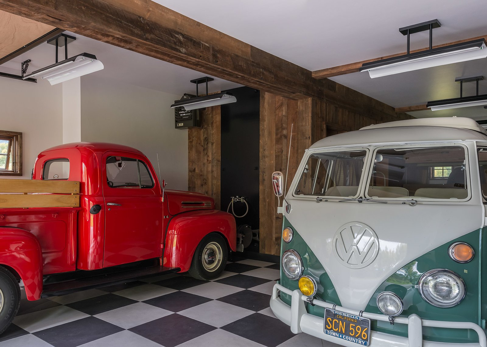 Garage and Storage Room Type Another view of the garage reveals its extensive space to house vehicles and protect them from the elements.  Photo 6 of 8 in A Guest Barn in Jackson, Wyoming, Fuses Modern and Rustic Elements