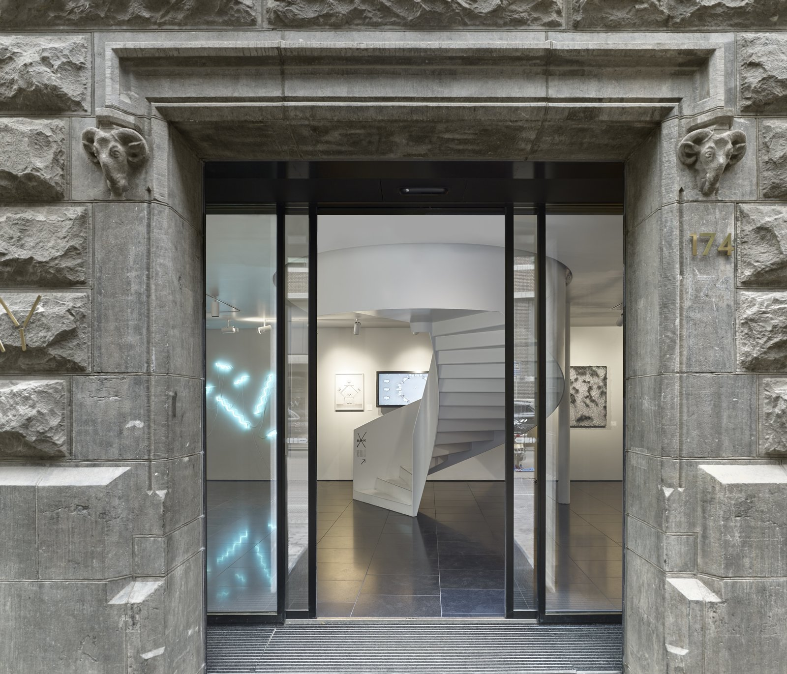 Staircase The entrance to X Bank showcases modern works of Dutch art and design which contrast the concrete exterior.  Photo 10 of 14 in Formerly a Historic Bank, This Amsterdam Hotel Honors its Stately Roots