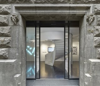 The entrance to X Bank showcases modern works of Dutch art and design which contrast the concrete exterior.