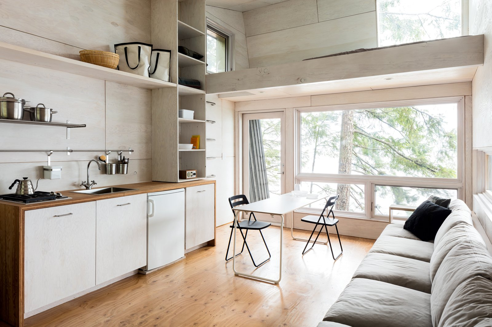 Kitchen, Wood Cabinet, Light Hardwood Floor, Drop In Sink, Dishwasher, Wood Counter, and Range  Photos from An Angled Cabin in British Columbia Makes an Ideal Island Retreat