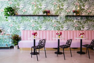 Holy Matcha in San Diego sports wall adorned with bright, floral wallpaper than tranforms the company's retail space.