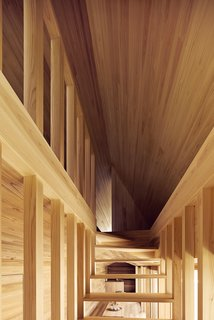 The Community-Run Cedar House by Airbnb and Go Hasegawa Welcomes Guests in Rural Japan - Photo 9 of 12 - The open staircase is seen here from the front—showcasing the dynamic lines that converge at the top of the stairway leading to the bedroom space.