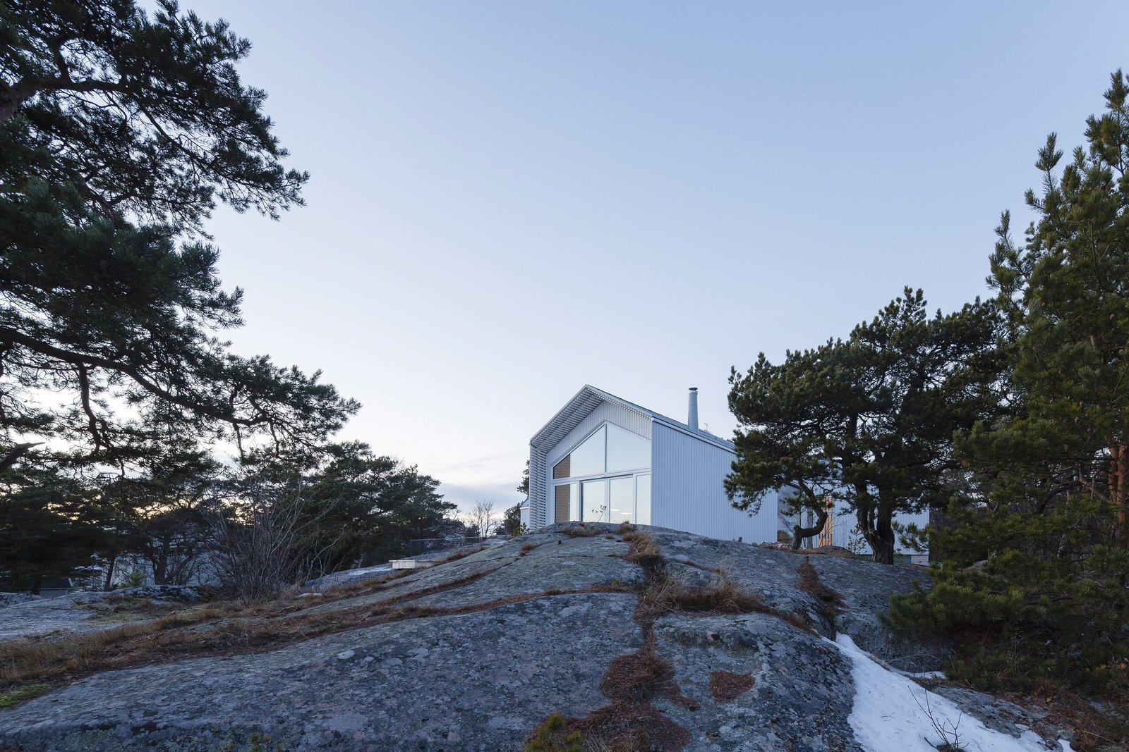 Outdoor, Slope, Trees, and Shrubs  Best Photos from A Modern Finnish Villa That Grows Out of a Seaside Cliff