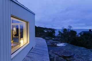 A Modern Finnish Villa That Grows Out of a Seaside Cliff - Photo 2 of 11 -