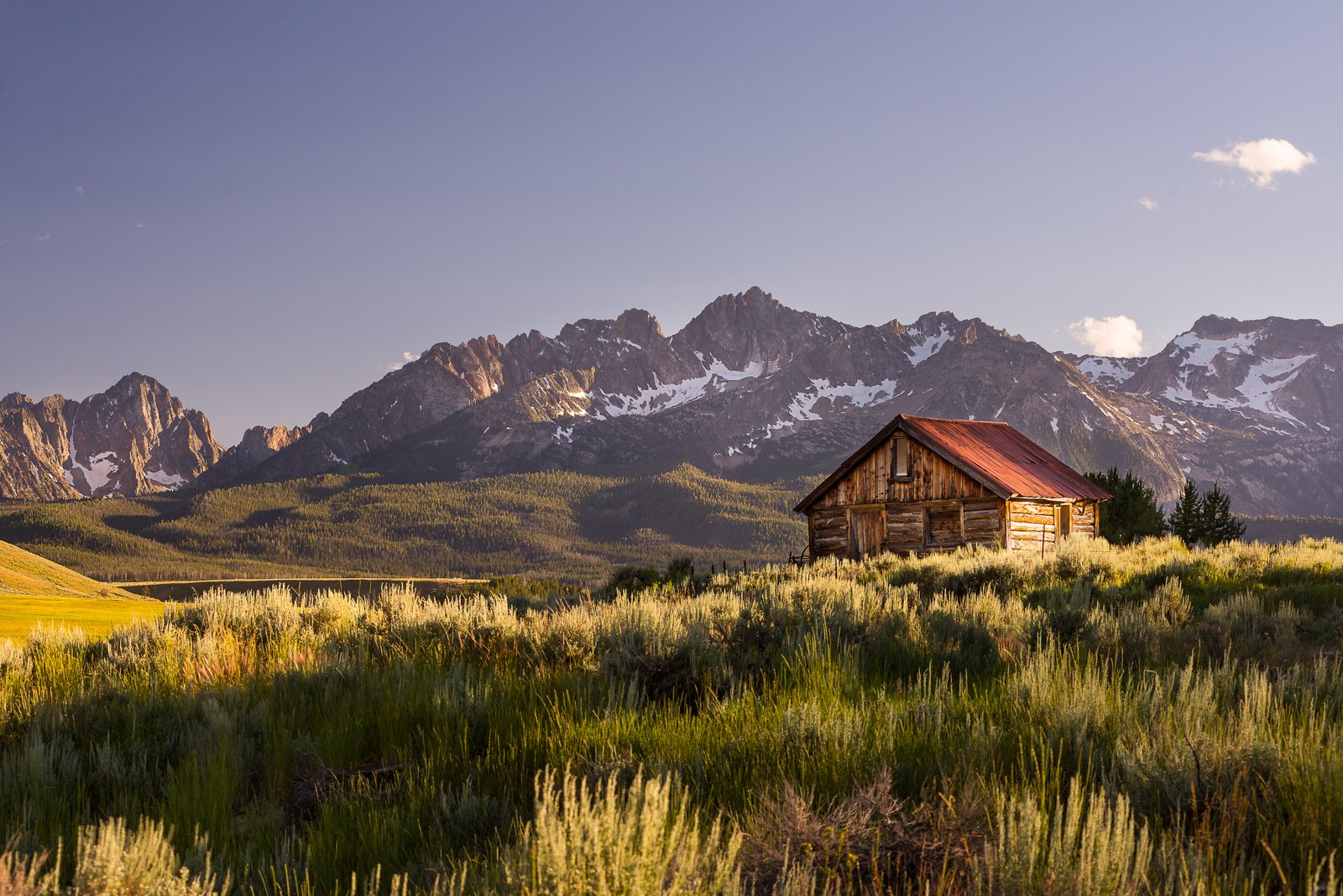 Evening light in the Sawtooth mountains of Idaho. Who wouldn't want to have a cabin here?  Cabins & Hideouts by Stephen Blake from Art and Architechture