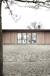 Spotlight on Multidisciplinary Danish Design Studio, Norm Architects - Photo 5 of 11 - The home has been designed as a long, narrow, flat-roofed pavilion to fit naturally with existing structures.