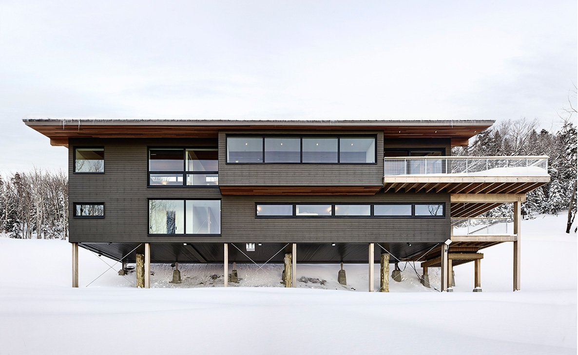 Exterior, Wood Siding Material, Metal Roof Material, Cabin Building Type, Shed RoofLine, and House Building Type  Laurentian Ski Chalet by RobitailleCurtis
