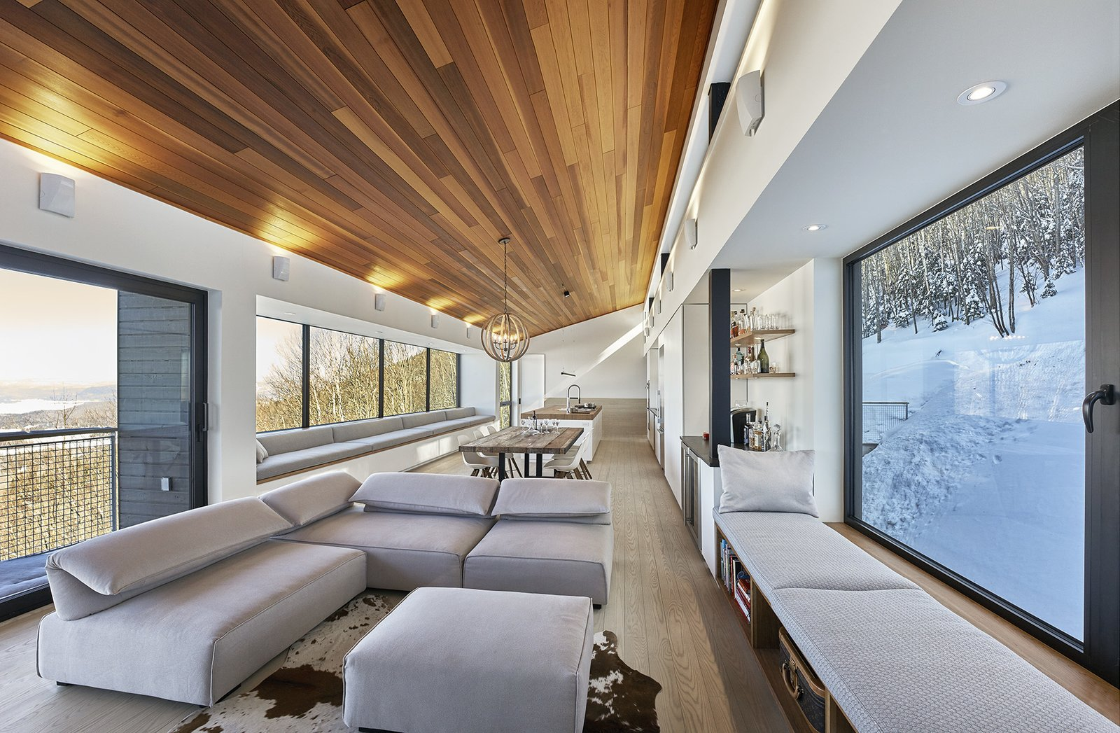 Tagged: Living Room, Bench, Sectional, Sofa, Wall Lighting, Light Hardwood Floor, Ottomans, Accent Lighting, Ceiling Lighting, Recessed Lighting, Medium Hardwood Floor, and Pendant Lighting.  Laurentian Ski Chalet by RobitailleCurtis