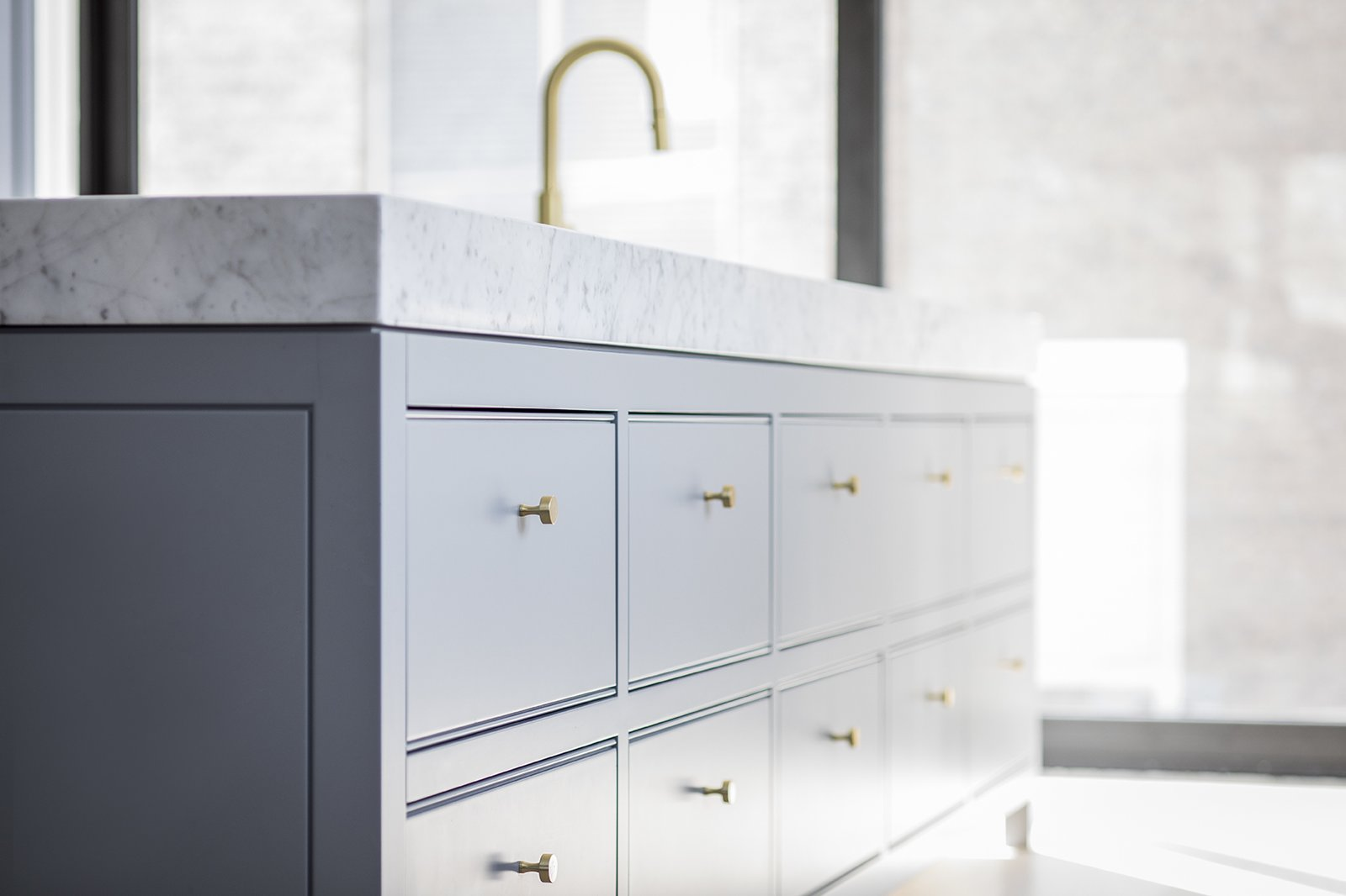 Kitchen, Marble Counter, Colorful Cabinet, Light Hardwood Floor, and Undermount Sink  Hampstead House by RobitailleCurtis